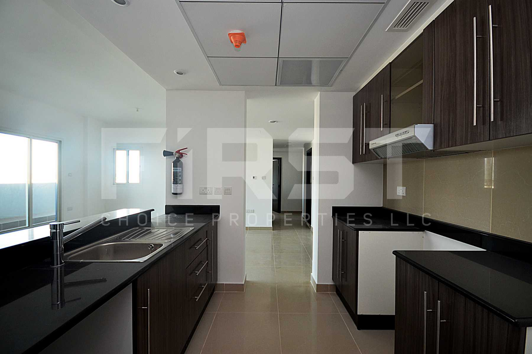 5. Internal Photo of 3 Bedroom Apartment Type D Open Kitchen in Al Reef Downtown Al Reef Abu Dhabi UAE 145sq.m 1560 sq.ft (7).jpg