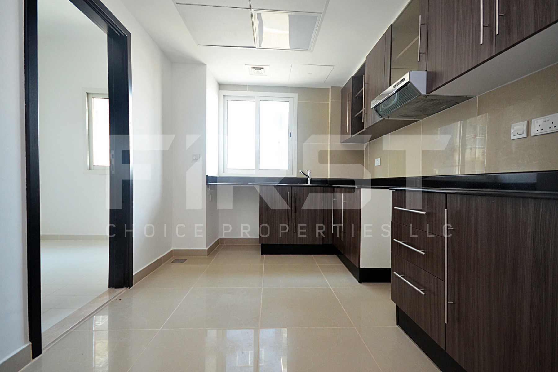Internal Photo of 3 Bedroom Apartment Closed Kitchen in Al Reef Downtown Al Reef Abu Dhabi UAE (6).jpg